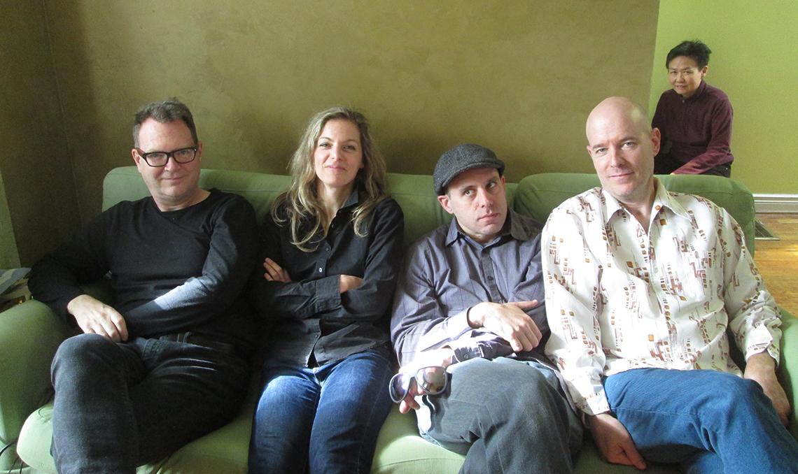 5 musicians posing