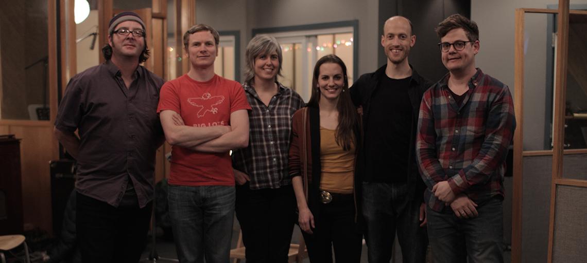 6 musicians posing
