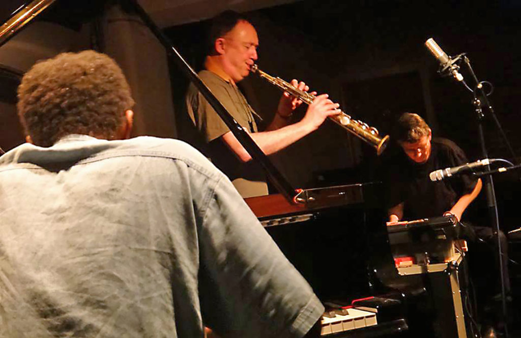 musicians playing piano, saxophone, sythesizer