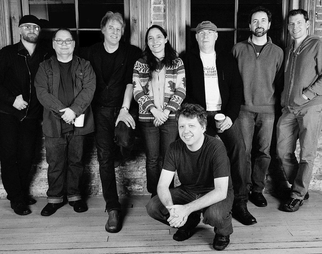 eight musicians posing